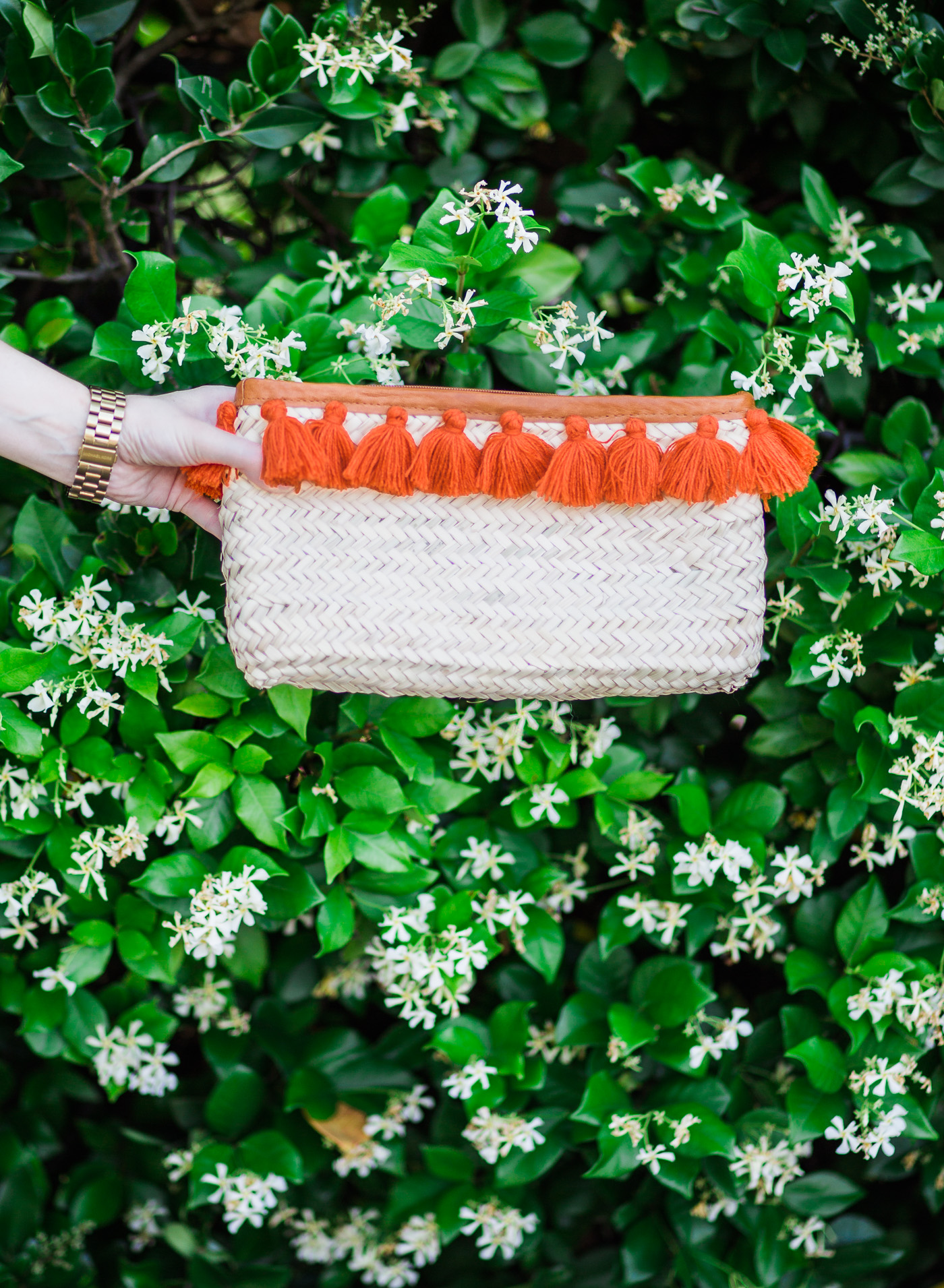 ORANGE TASSEL MOROCCAN STRAW CLUTCH